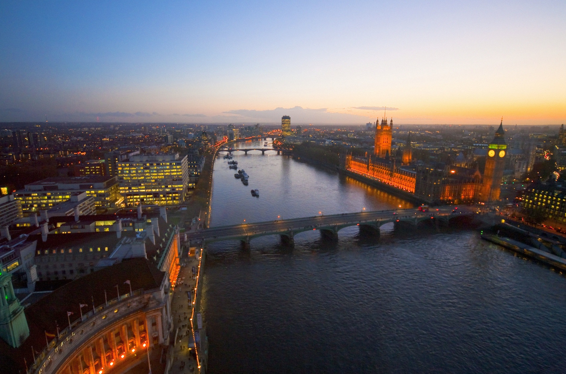 Aerial view of the River Thames, Houses of Parliament and Westminster Bridge at dusk